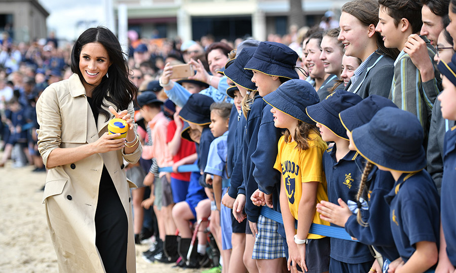 The duchess looked thrilled to have received an adorable little sippy cup from one of her admirers at South Melbourne Beach.