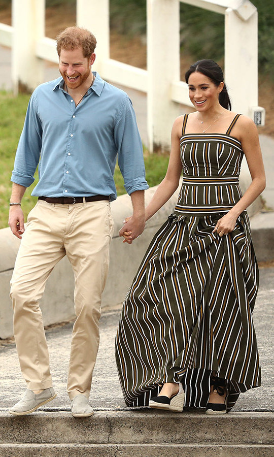 Meghan slipped into her go-to designer, Aussie-born Martin Grant, once again. The expectant royal stunned in his striped maxi dress and black Castaner espadrilled, which she paired with a loose ponytail and bronzed complexion with a rosy lip for a visit to Bondi Beach on Oct. 19. 