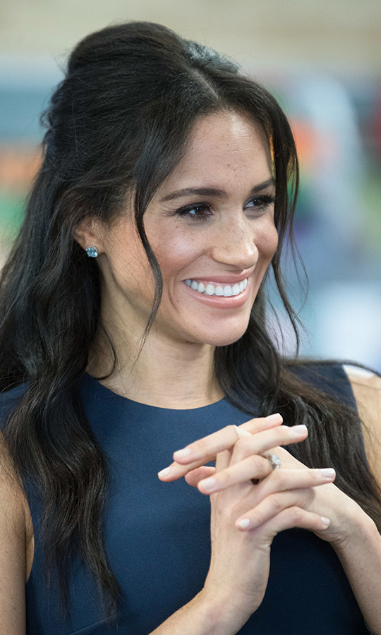 The former Toronto resident also turned to her Canadian fave Birks for jewellery (the Bee Chic blue topaz earrings and Rosée du Matin White Gold 'Flex Wrap Bracelet'). Meghan's makeup was decidedly natural with a peachy lip and light smokey eye.