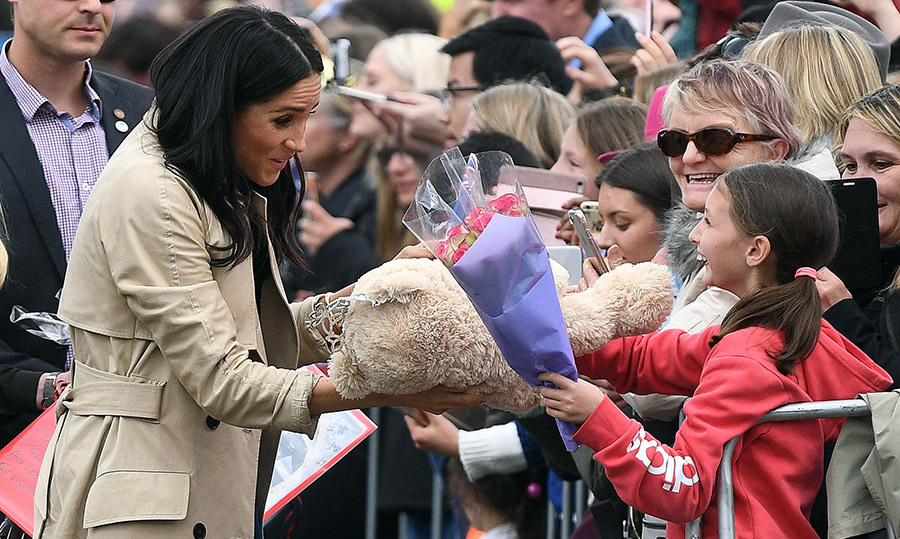 A very excited young girl had her chance to give Meghan a bouquet of flowers, and a big stuffed teddy bear with a crown on top!