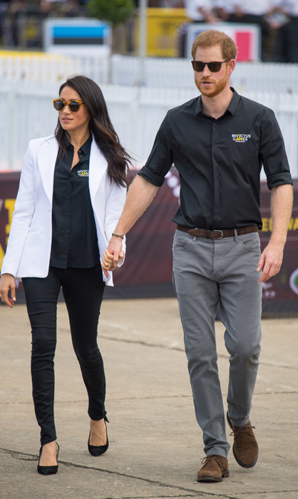 Earlier in the day on Oct. 20, the casual couple took a boat to Cockatoo Island, where they got to watch the Jaguar Land Rover Driving Challenge. Meghan stunned in black jeans by Mother Denim, a white Altuzzara 'Acacia' blazer, pumps by Tabitha Simmons, an Invictus Games official button-up shirt and Illesteva Palm Beach Sunglasses.