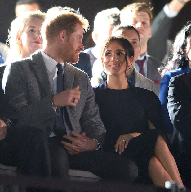 The Sussexes sweetly clasped hands and chatted before the opening ceremony began.
