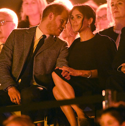 Harry whispered in Meghan's ear during the opening ceremony – a sweet recreation of one of the photos taken of them at their first Invictus Games in Toronto.