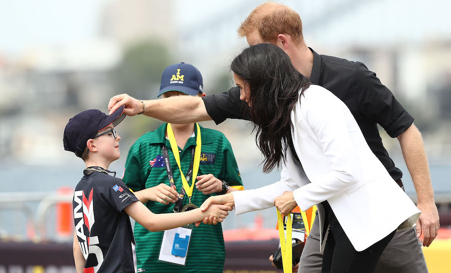 And what's an Invictus Games without a few sweet photos with youngsters? Prince Harry and Meghan helped hand out winning medals to the young drivers on Cockatoo Island.