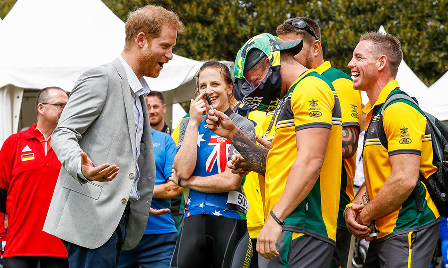 Though his pregnant wife Meghan ended up skipping the Invictus Games cycling time trial event on Oct. 21, the Duke of Sussex was his typically charming self, joking around with competitors - and being asked to sign a pair of budgie smugglers? (That's men's Speedo-style swimwear, for those of us on this side of the pond!). He politely declined!