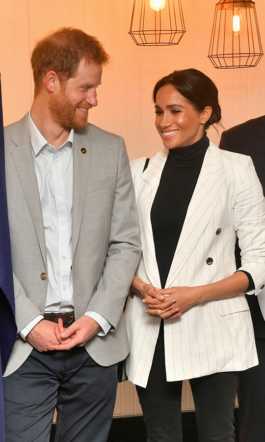 The parents-to-be were all smiles as they reunited for the event after Meghan missed the morning's cycling time trial. Prince Harry was clearly happy to have his partner back by his side!