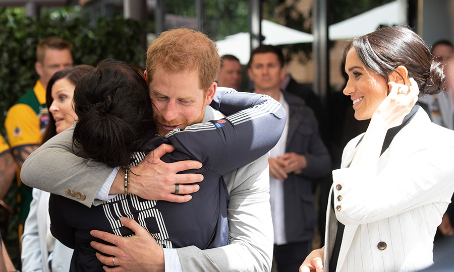 Prince Harry had the sweetest reunion with Team UK vice captain Michelle Turner, sharing a huge hug as Meghan looked on happily.