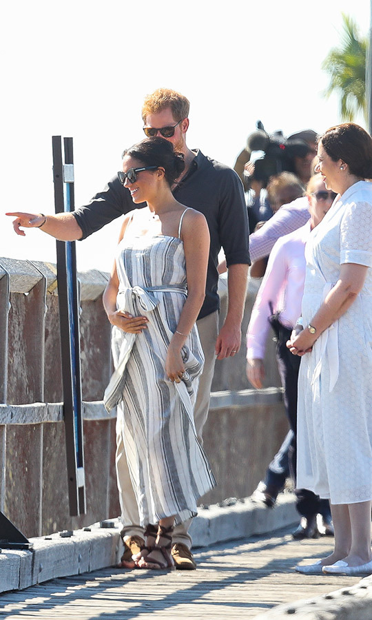 "Prince Harry and Meghan were happily reunited on the jetty at Kingfisher Bay after the dad-to-be enjoyed a day of solo engagements on Fraser Island. Though his pregnant wife opted to take some time off to rest at the luxe Kingfisher Bay resort, an insider insisted that ""She is not sick or exhausted and is feeling fine, and in fact she spent some time preparing for the coming days of the tour while the Duke was out on duty."" 