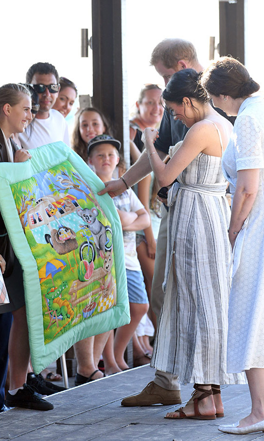 "A fan presented the pair with a stunning handmade quilt, complete with a koala bear and a kangaroo! Harry was also given pause over a sign that read ""Rangas Rule"" - a reference to the Australian slang word for redheads.