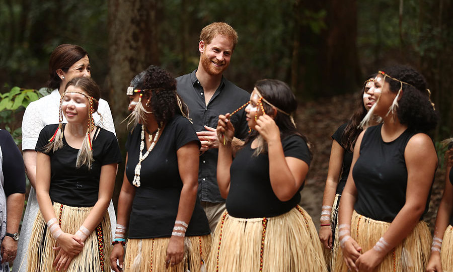 Prince Harry clapped along as he took in a performance by young Butchulla dancers. 
