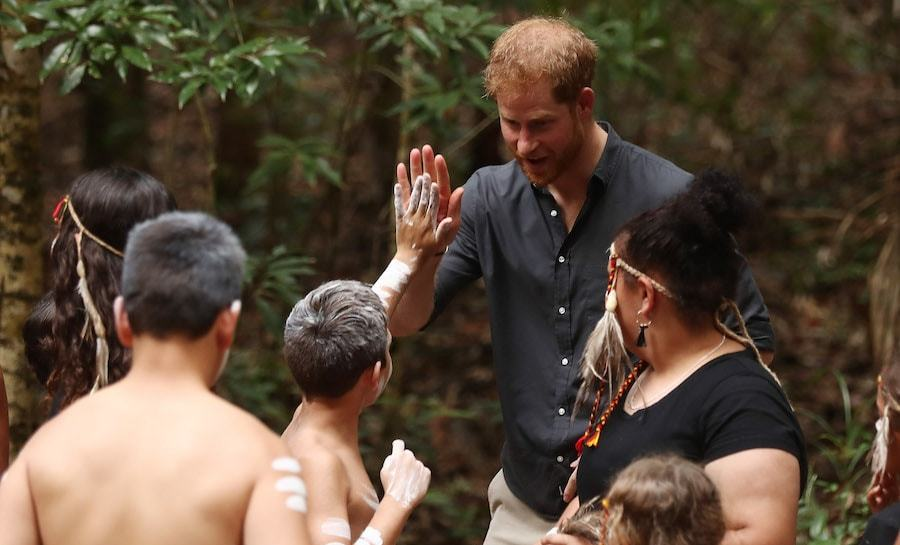 The duke's way with kids comes so naturally – it's no wonder he's such a loving uncle, and will be the best father to Baby Sussex! Harry, without Meghan, met with the tribe of K'gari, where he gave a sweet high five to a youngster.