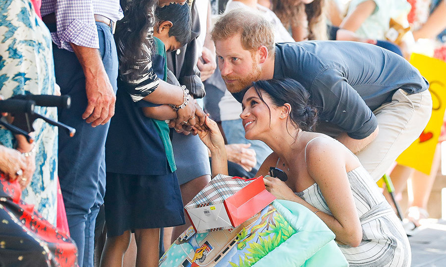 On Oct. 22, Meghan and Harry had an exciting walkabout on Australia's Fraser Island – and a lucky little fan scored himself a royal handshake!
