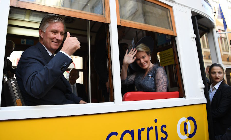 All aboard! King Philippe and Queen Mathilde waved during their tram ride as they visited downtown Lisbon.