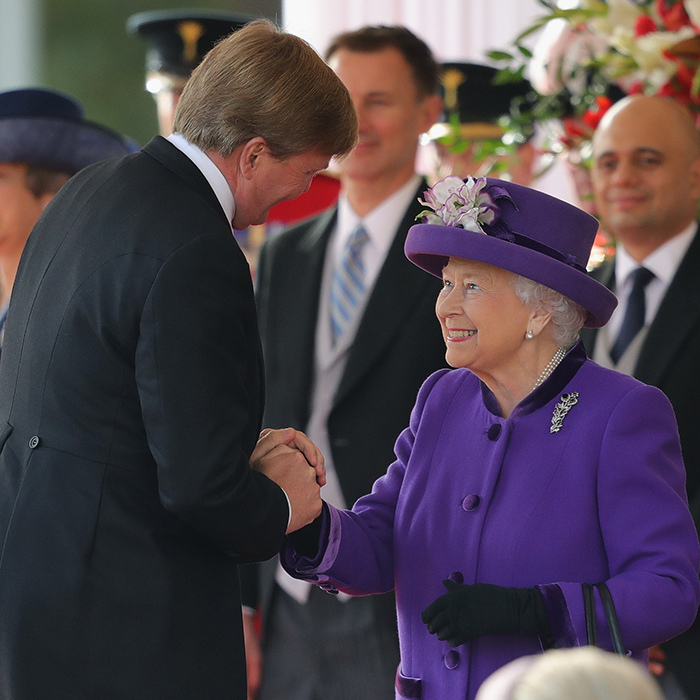 A big smile for King Willem-Alexander! Her Majesty greeted the Dutch king during a ceremonial welcome at Horse Guards Parade.