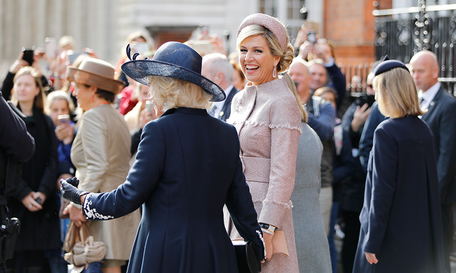 The Duchess of Cornwall and Queen Máxima looked thick as thieves as they laughed while walking close together.
