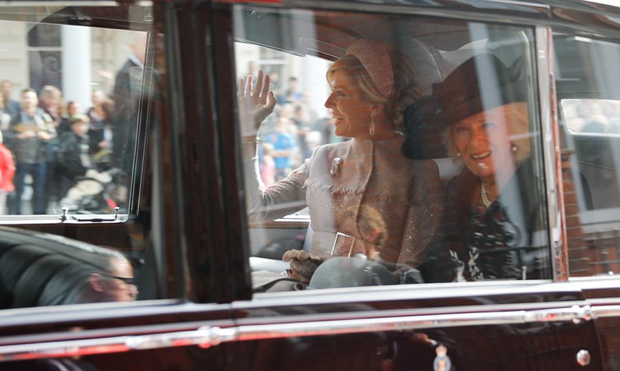 The duo showed off their megawatt smiles while leaving the Dutch ambassador's residence by car.