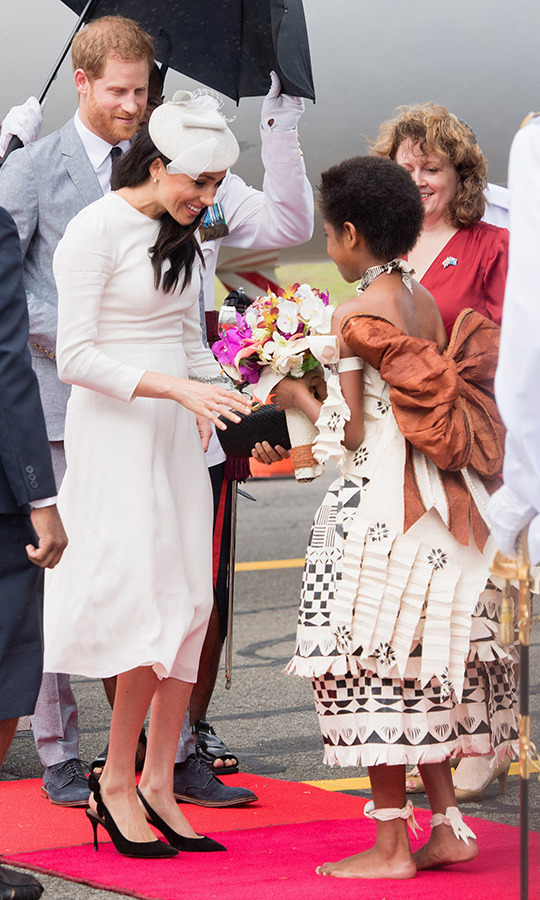 The 37-year-old met a young girl from the chiefly island of Bau, which Her Majesty visited in 1982. It was the island home of Ratu Apensia Cakobau, who ceded the country to England in 1874. The flower girl presented Meghan with a stunning bouquet. 