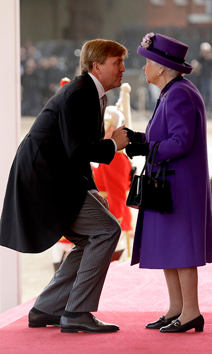 A dapper Willem-Alexander got on the Queen's level for a kiss on the cheek as he arrived at Buckingham Palace.