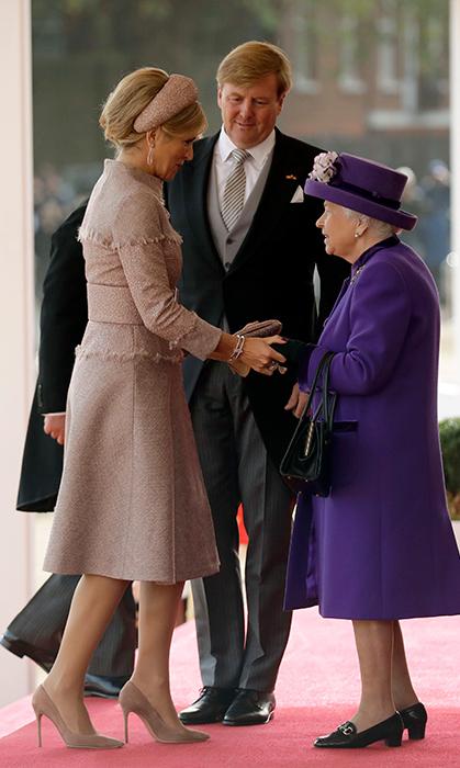 A curtsy for the Queen! The 43-year-old royal, known for her sartorial savvy, stunned in a mauve skirt suit and matching headband fascinator, pairing the look with beige suede heels.