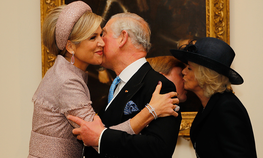 The mother of three got a big kiss and a hug from the Prince of Wales.