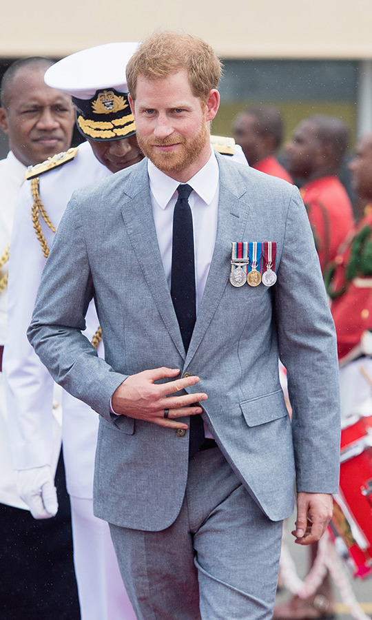Prince Harry looked dapper in a light grey suit, white shirt and tie with his medals proudly displayed.