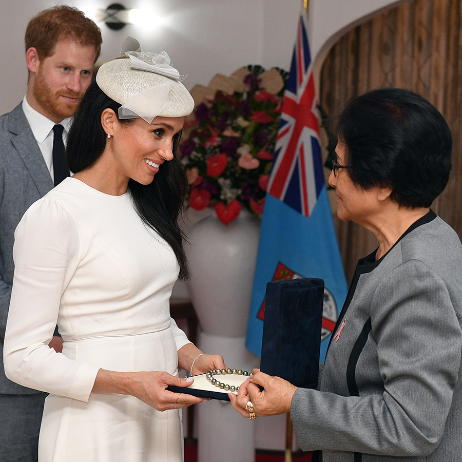 The president's wife presented Meghan with a beautiful pearl necklace.