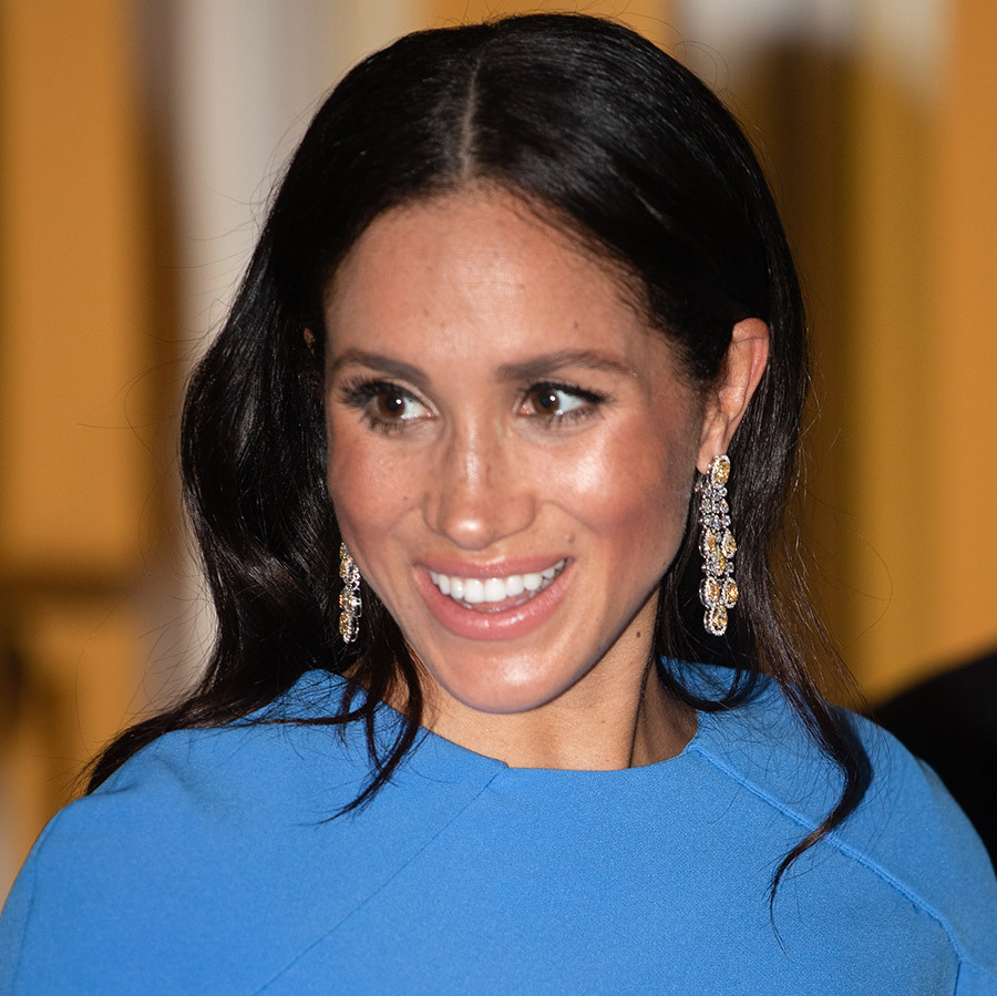 Meghan's go-to black-tie beauty look was on full display - dewy, luminous skin with rosy cheeks, a smokey eye and glossy pink lips. She parted her hair in the centre and wore her sleek, shiny locks cascading over her shoulders.