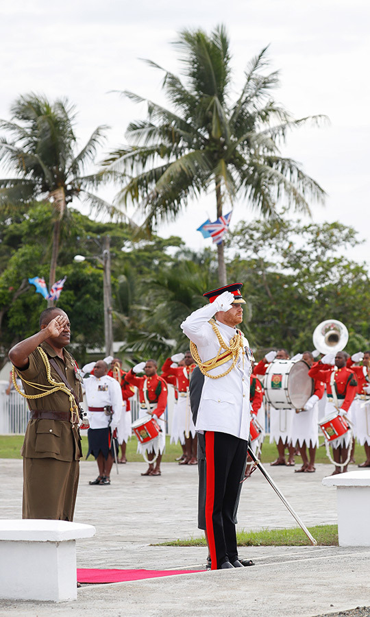 "On day two of the Sussexes' Fiji tour, Prince Harry headed out solo to lay a wreath at the country's war memorial and meet some of Fiji's veterans, some of whom fought with the British Armed forces. The duke wore his tropical Blues and Royals uniform as he saluted during the ceremony and gave a speech. ""I must emphasize my respect, admiration and camaraderie with the Fijian soldiers that I served with in Afghanistan,"" he said. ""We trained together, we fought together, and most importantly we laughed together.""