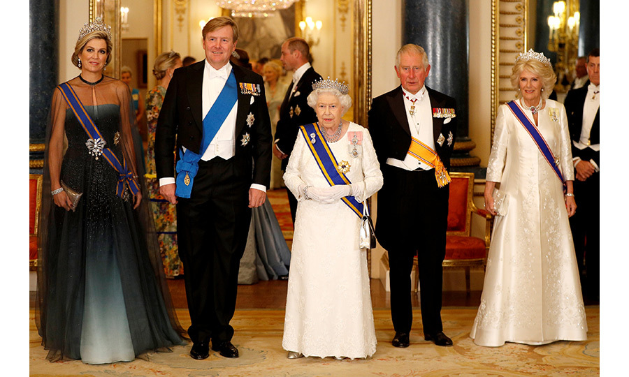 The Queen welcomed King Willem-Alexander and Queen Maxima in high style on the first night of their visit with a state banquet attended by Prince Charles, Camilla and their good friends Prince William and Kate, as well as other royals and VIPs. The group posed for a photograph, with the Queen in the Girls of Great Britain and Ireland tiara, Camilla in the Greville tiara and Maxima in the breathtaking Stuart tiara. 