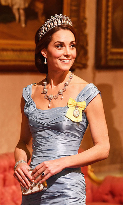 In addition to her stunning tiara and earrings, Kate wore a necklace steeped in history. Queen Alexandra's Wedding Parure necklace was a gift from Albert Edward, Prince of Wales, ahead of their wedding in 1863. On the left side of her dress, she affixed the Royal Family Order for the second time ever (she first wore it last December to the Diplomatic Corps reception). It is a personal gift from the Queen to members of the family.