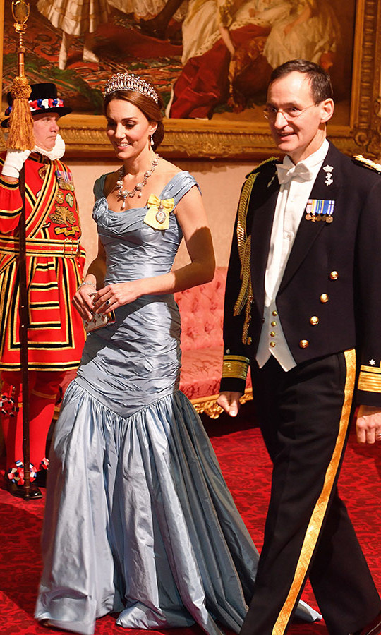 Kate dazzled in an ice-blue mermaid-style gown by Alexander McQueen, which featured a gathered bodice and cap sleeves. She topped it off with the Cambridge Lover's Knot tiara, the topper she's worn most often and a favourite of her late mother-in-law Princess Diana. She also wore the late royal's Collingwood Pearl earrings.