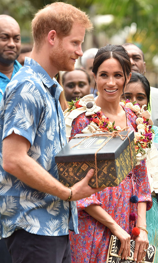 The couple, with Prince Harry clad in a blue and white Bula shirt, received a sweet gift from the university. 