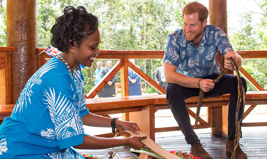 Prince Harry showed off his megawatt smile while watching a woman demonstrate how to traditionally weave a mat.