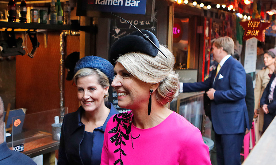 The two royal women stunned in their very different, but equally as elegant, outfits. Sophie went with navy blue, while the Dutch queen dazzled in magenta.