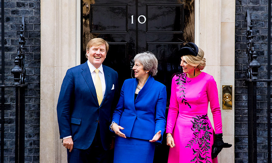 King Willem-Alexander must've said something funny! The Dutch royal couple were visiting with Prime Minister Theresa May at Downing Street 10.