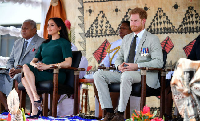 The Duke and Duchess of Sussex watched on as the statue was being prepared to be unveiled. Meghan brought out all her fashion savvy for day three in Fiji, dazzling in a hunter green shift dress by one of her go-to Canadian designers, Jason Wu.