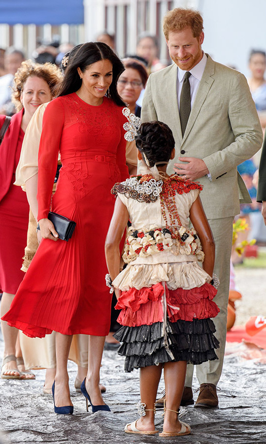 The couple met a sweet fan in traditional Tongan attire while being welcomed to Nuku'alofa.