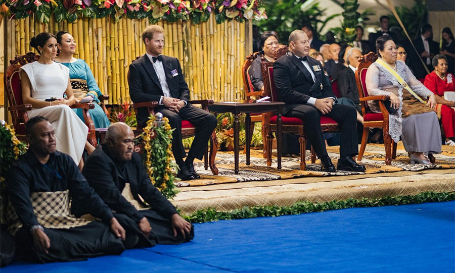 The Sussexes sat outside during the welcome reception and dinner alongside His Majesty King Tupou VI and Queen Nanasipau-u. 