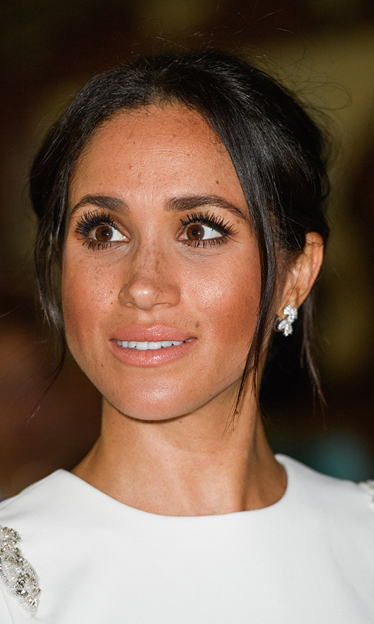 The Duchess of Sussex went big with her lashes at the Tongan welcome dinner, both top and bottom, pairing the eye-popping feature with bronzed skin, rosy cheeks and a pinky nude lip. She had tendrils framing her face with her hair in a high bun, a departure from her usual low and messy updo.