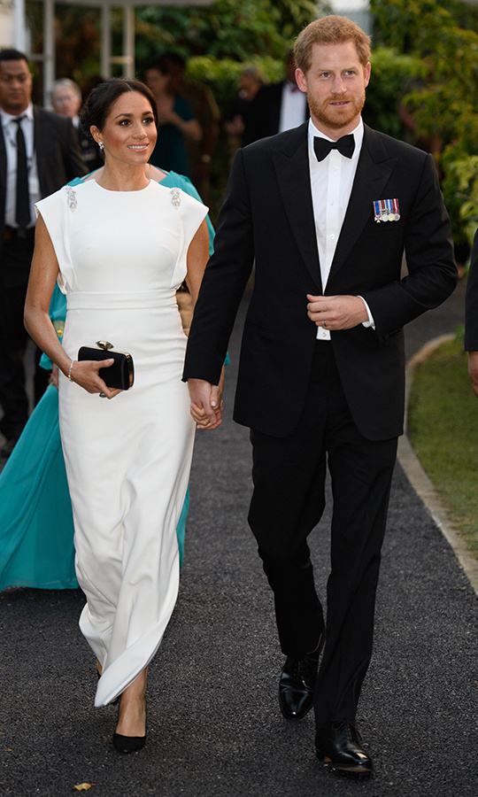 Meghan was a vision in white wearing a gown created by New York's Theia Couture. The column design featured oversized cap sleeves with beaded silver appliques and a nipped waist, which Irish designer Don O'Neill revealed had to be let out to accommodate her pregnancy. She paired the striking gown with Aquazzura heels, a Givenchy Clutch, Birks earrings and the piece de resistance: Princess Diana's aquamarine cocktail ring!