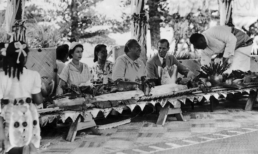 """Coming to Tonga I feel very much as though I am coming to visit an extended family,"" Prince Harry said. ""My grandparents have visited a number of times and Your Majesties have been frequent visitors to see my family over the years."" Here, Prince Philip and the Queen broke bread with Queen Salote Tupou III on their first visit to Tonga in 1953.