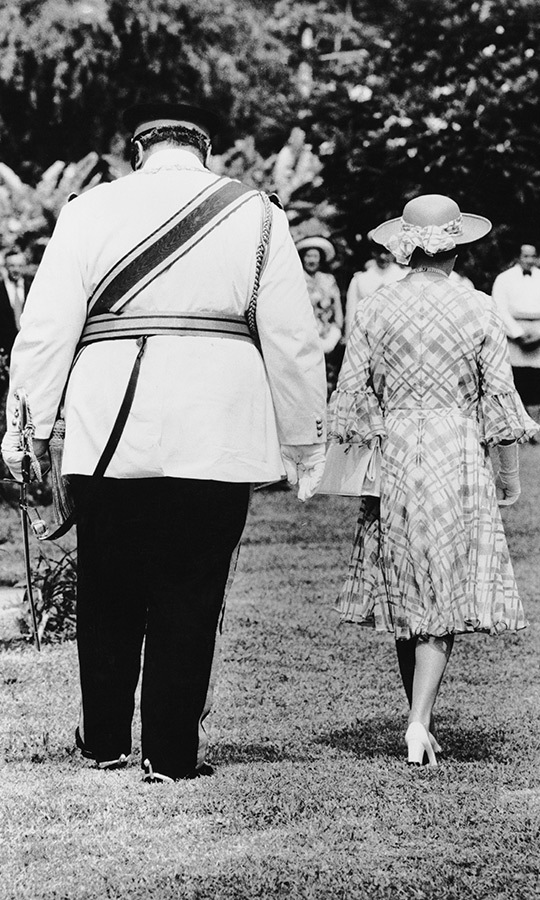 The two monarchs enjoyed a stroll through the grass.