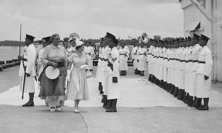 The Queen surely inspected a lot of troops during her coronation world tour in 1953! The monarch was greeted by her host, Queen Salote Tupou III, on arrival in Nuku'alofa, where she had a gander at the Royal Guard.