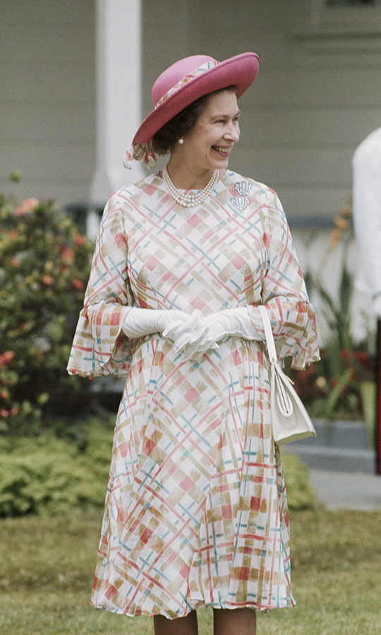 The Queen was all smiles on the day of her arrival in Tonga in February 1977, wearing a pretty printed dress with flared sleeves, a matching pink hat and gloves.