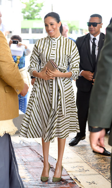Meghan dazzled in a green-and-white striped dress by Australian designer Martin Grant, who she's worn before during their royal tour. She paired the look with olive-green pumps (the same ones she wore to Prince Louis' christening!) and a Prada bag.