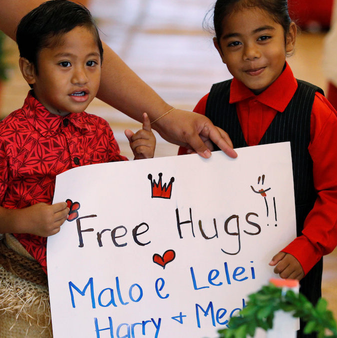 These two youngsters definitely had the cutest sign to welcome Prince Harry and Meghan at the Fa'onelua Convention Centre, in Nuku'Alofa, Tonga.