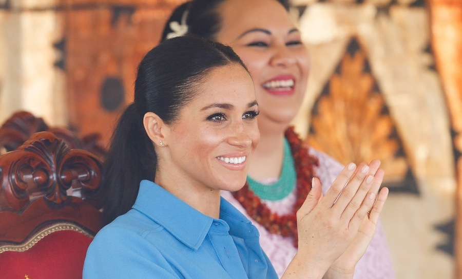 The Duchess of Sussex sat with Princess Angelika Latufuipeka while watching the Unveiling of The Queen's Commonwealth Canopy at Tupou College.