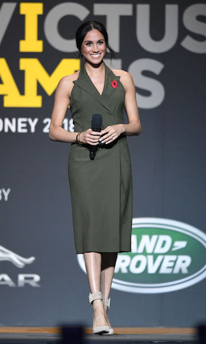 The Duke and Duchess of Sussex closed out the Invictus Games with a bang – a fashionable one! Meghan revisited the tuxedo dress, this time wearing an olive-green halter style by British designer Antonio Berardi. She completed the look with her pair of Aquazzura 'Casablanca' pumps and two Pippa Small bangles.