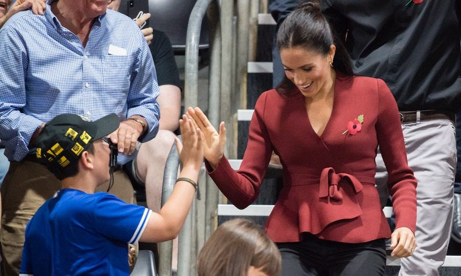 High fives for the kids! As the duchess entered the Quay Centre for wheelchair basketball, she made sure to greet all her sweet fans.