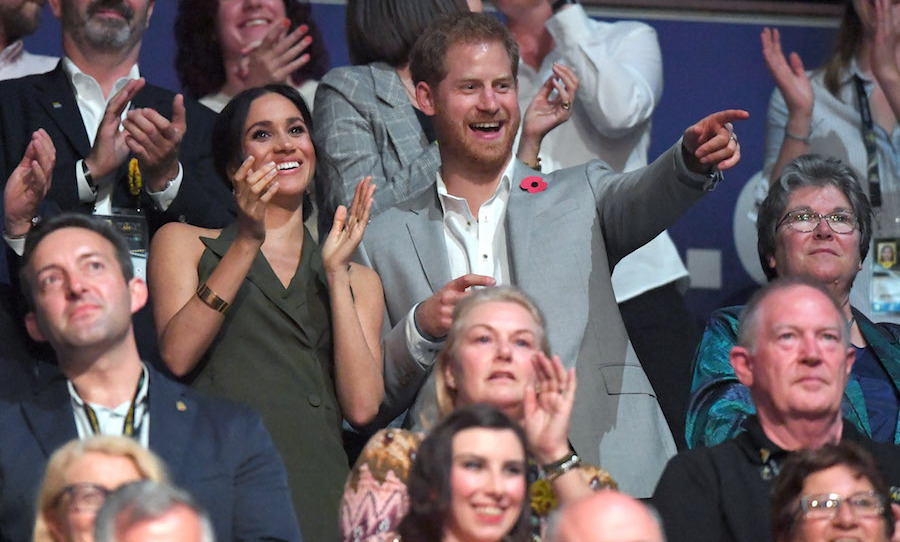 The couple looked happy as ever at the closing ceremonies, as Prince Harry pointed something out to Meghan.
